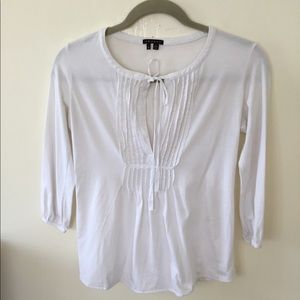 Theory white pull over blouse with tie in front. S